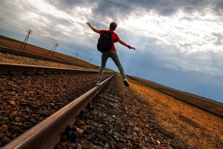 abandonment: Teen girl with problems walking on old rail road Stock Photo