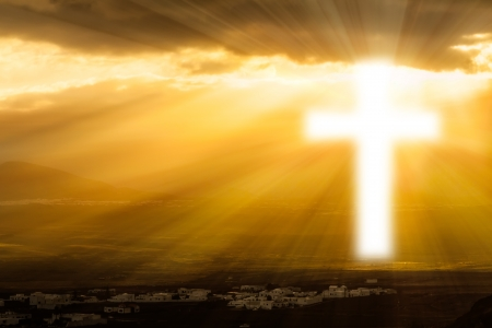 Christian cross glows against the rising sun