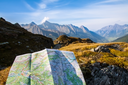 tripping: touristic map on Alps mountain background Stock Photo