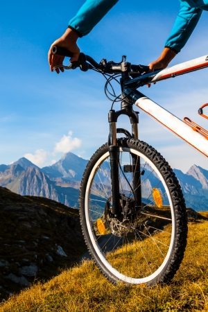 sommer: Mountain bike wheel and sommer alpine  landscape