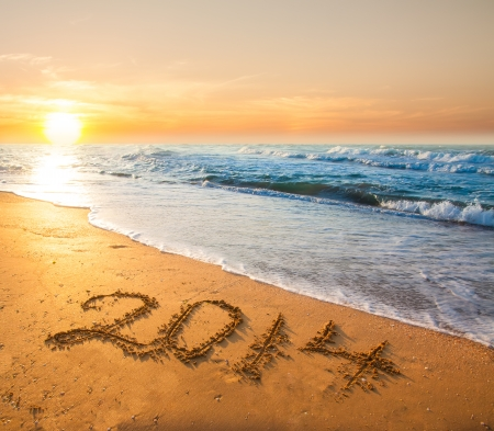 new year 2014 digits on ocean beach sand Stock Photo - 23570324