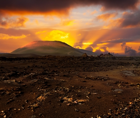 timanfaya: Dramatic Sunset over volcano and lava desert, Lanzarote, Canary islands,
