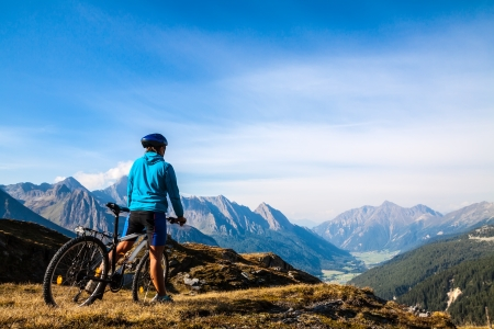 weekends: Mountain biking - woman on bike, Dolomites, Italy Stock Photo