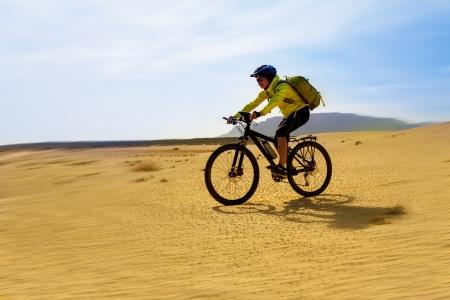 lanzarote: woman in yellow riding bike on on Canary island
