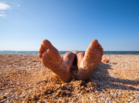 funny feet on warm summer  beach Stock Photo - 24523557