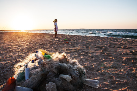 Beach pollution  Plastic bottles and other trash on sea beach