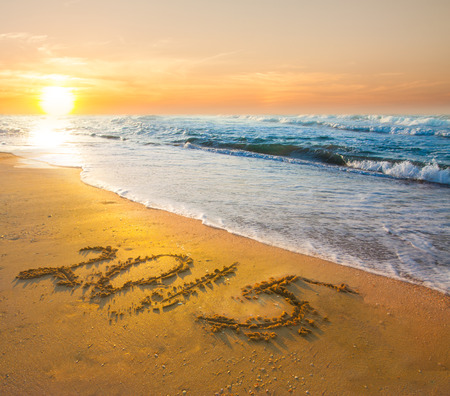 new year 2015digits on ocean beach sand