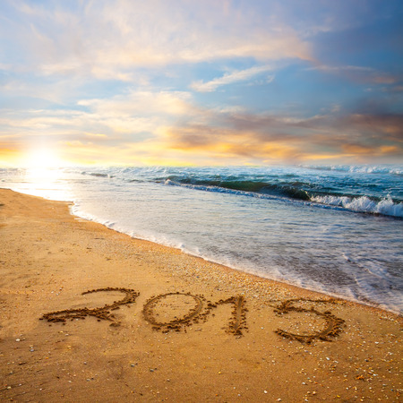 new year 2015 digits on ocean beach sand