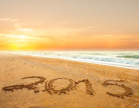 new year 2015 digits on ocean beach sand photo
