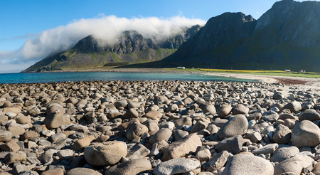 arctic waters: Summer panoramic view to beach and mountains at Unstad, Lofoten Norway