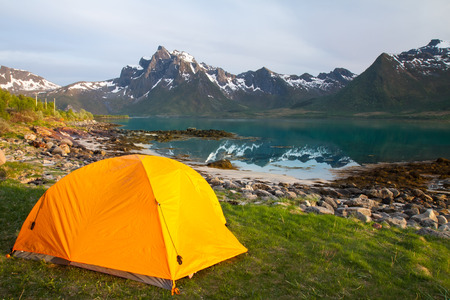 camping tent: tourist tent on lakeside in mountains,  summertime, Norway