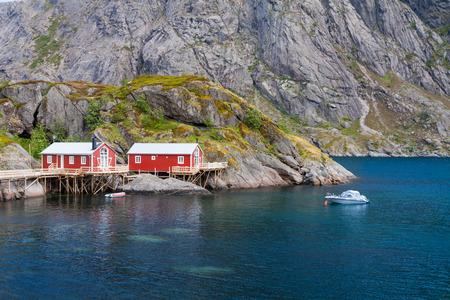 rorbu: Typical red rorbu fishing hut in town of Svolvaer on Lofoten islands in Norway lit by midnight sun