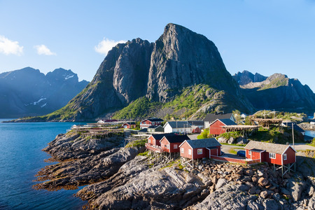 island: Scenic town of Reine by the fjord on Lofoten islands in Norway on sunny summer day