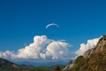 oludeniz: Paraglider flying over sky and mountains in summer day, Oludeniz, Turkey