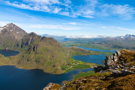 rorbuer: Panorama of scenic fjord on Lofoten islands with towering mountain peaks, Leknes Stock Photo