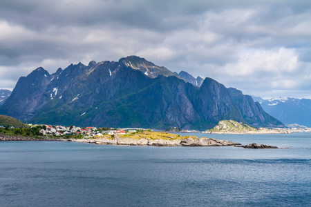 rorbuer: Scenic town of Reine by the fjord on Lofoten islands in Norway on sunny summer day