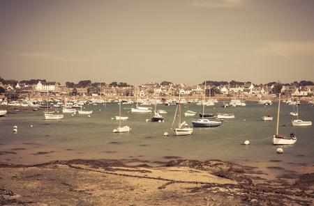 ebb: Fishing boat at ebb tide in Bretagne, France, vintage style