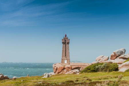 cote de granit rose: Ploumanach lighthouse in Perros-Guirec, Brittany, France. The Pink Granite Coast