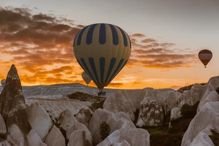 adventure aeronautical: Hot air balloon flying over Cappadocia region, Turkey