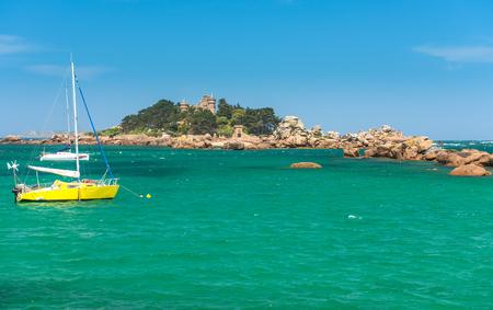 bretagne: Fishing boat and island in Bretagne, France Stock Photo