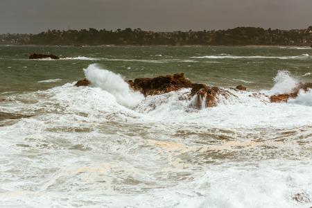 waves crashing: big waves crashing on rocks, Bretagne, France