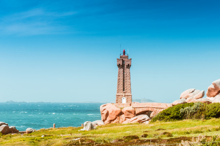 Ploumanach Mean Ruz lighthouse pink granite coast, Perros Guirec, Brittany, France