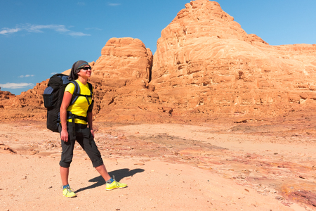 sinai desert: Woman mountain Hiker with backpack enjoy view in Sinai desert Stock Photo