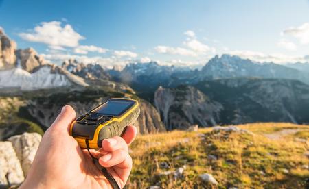 GPS navigator in hand against Dolomites Alps Imagens