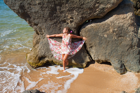 Young attractive girl posing on summer beach