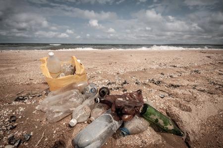 trashy: Dump on sea beach  plastic bottles on sand