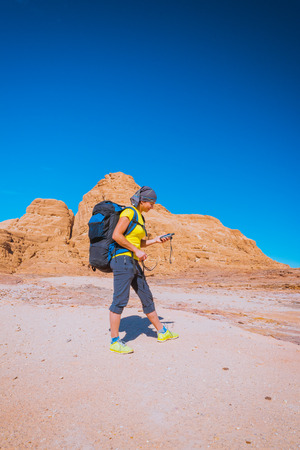 sinai desert: Woman mountain Hiker with backpack and GPS in Sinai desert Stock Photo