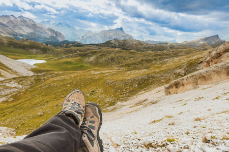 hight: Hiker relaxing in hight mountains, Alps, Italy Stock Photo