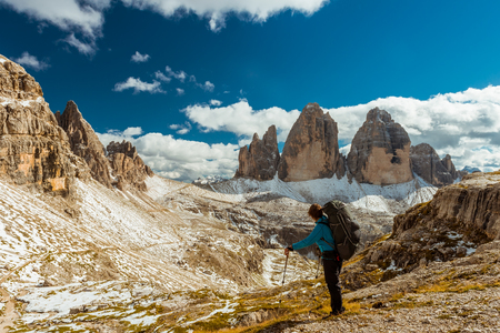 met: Woman hiker on top of  mountain, Dolomites, Italy Stock Photo