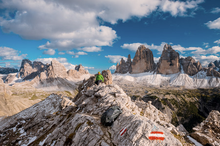 Hiker enjoying view from top of mountain, Dolomites, Italy Stock Photo