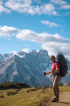hiker in front of Alps mountains, Dolomites, Italy Stock Photo