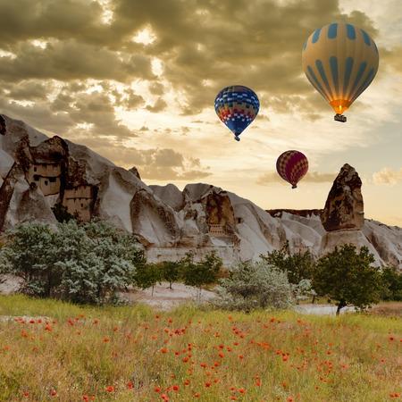 Hot air balloon trip flying over landscape at Cappadocia