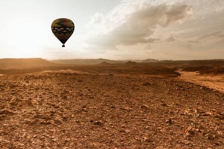 air travel: Hot Air Balloon travel over Africa desert