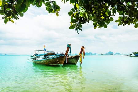 aonang: Long tail boat on tropical Railay beach, Aonang, Krabi, Thailand