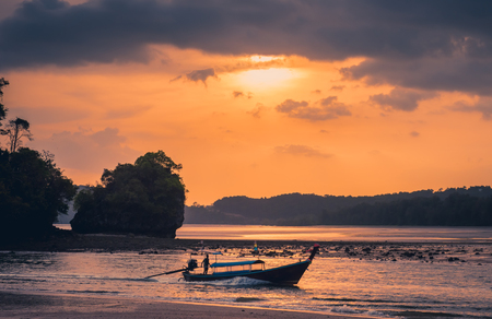 Traditional thai longtail boat at sunset beach. Ao Nang, Krabi province. Stock Photo