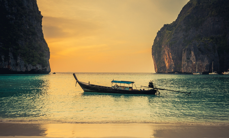 Sunset Phi phi Le island bay and longtail boat, Andaman Sea - Thailand Stock Photo