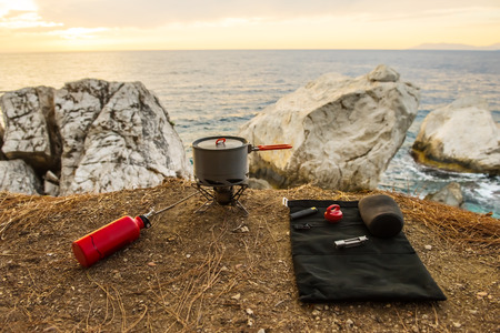 butane: Tourist equipment and tools: camping gas over sea background