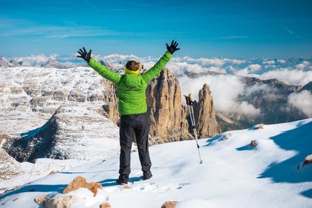 Happy tourist hiking in mountains Dolomites, Italy