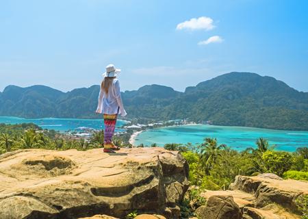Tourist woman admire tropical Thailand Phi phi island and lagoon Stock Photo