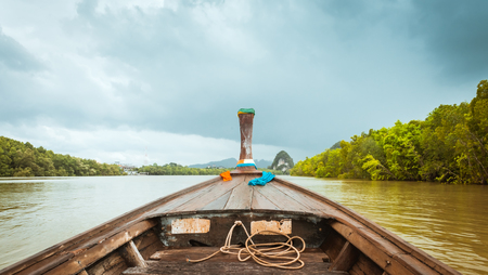 Traditional wooden longtail boat on Pak Nam Krabi river, Thailand
