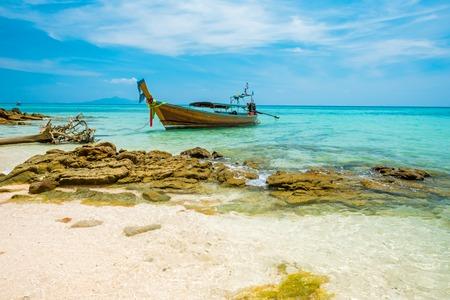 Koh Bamboo island bay and longtail boat, Andaman Sea - Thailand