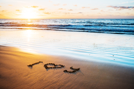 I love you word on sand beach on sun and wave background Stock Photo