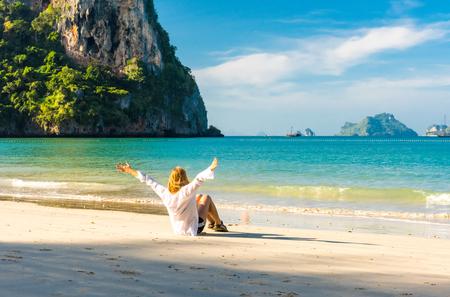 Woman resting on amazing Railay beach in Krabi Thailand. Tropical resort.