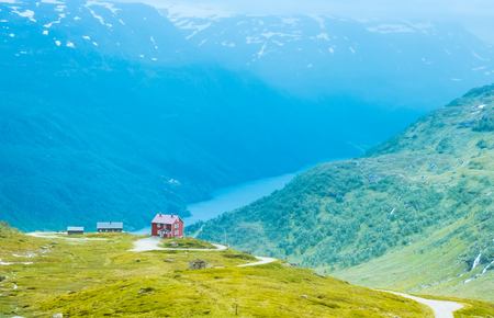 The lonely house on mountain lake in Norway, rainy weather