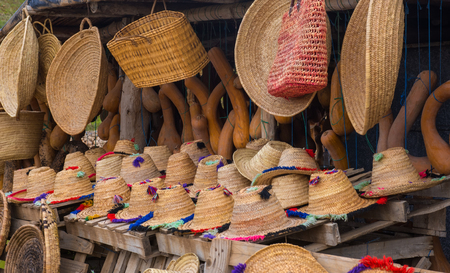 Craft wicker hats, bags and other souvenirs in the market of Morocco