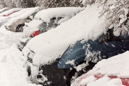 Winter cars covered with fresh white snow Stock Photo